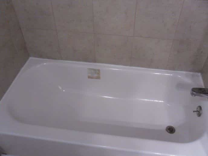 Finished Bootzcast tub installation with tile tub surround