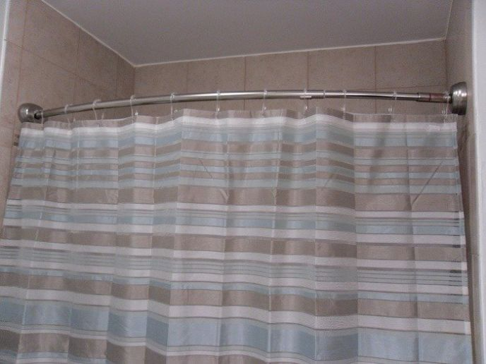 How to keep the shower curtain from blowing into the shower!