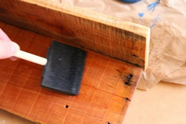 Applying Danish oil to DIY baseball hat rack