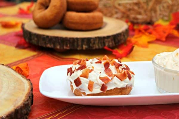 Bacon topped pumpkin donuts with cream cheese frosting
