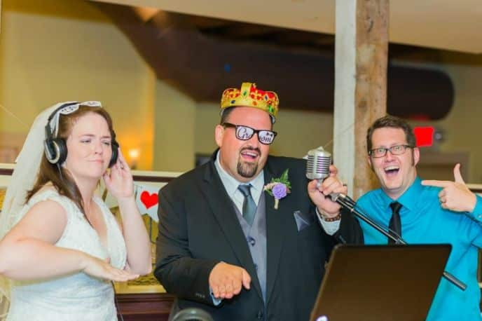 Andrew and Katie at Wedding with props and DJ