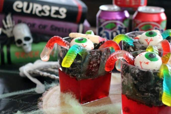 Graveyard Jello with Gummy Eyeballs, Gummy Worms and Chocolate Cookies