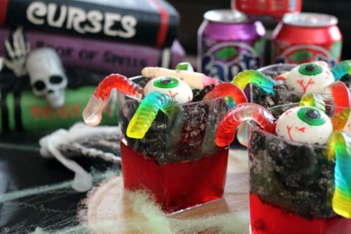 Graveyard Jello with Gummy Eyeballs, Gummy Worms and Chocolate Cookies
