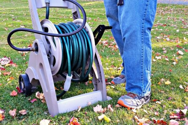 Packing up garden hose for winter, fall home maintenance checklist