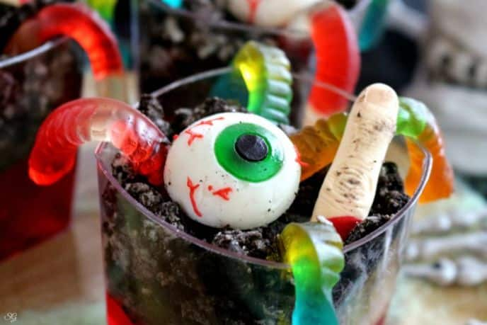 Haunted Spooky Jello with Gummy Worms and Gummy Eyes and Chocolate Cookies