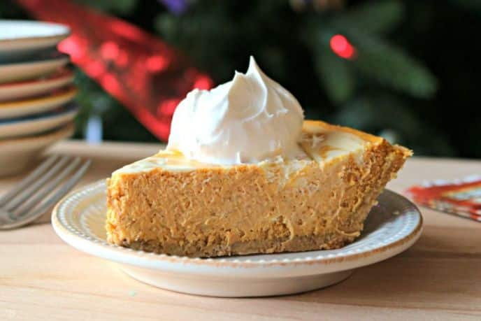 Pumpkin Cheesecake Recipe. An easy pumpkin cheesecake recipe for holiday celebrations. Check out this easy pumpkin swirl cheesecake recipe.