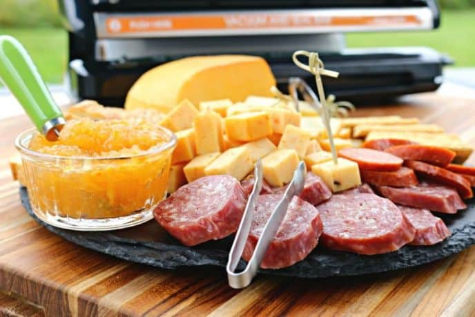 How to smoke cheese, served with smoked meat and crackers.