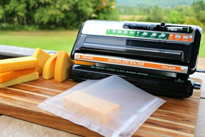 Cold smoking cheese and vacuum sealing with a Foodsaver to seal in the smoke flavor and age the cheese.