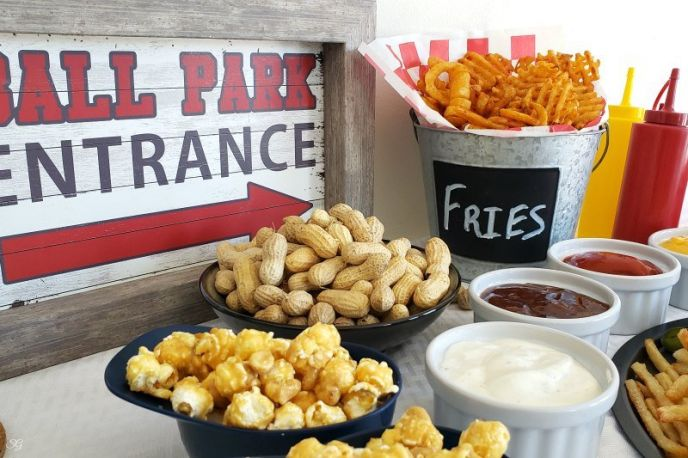 Game day snacks! Peanuts, caramel popcorn, french fries and recipe for steak and cheese loaded fries. #easyrecipe #MyMcCainPotatoes #McCainPotatoes #steak #cheesy #fries