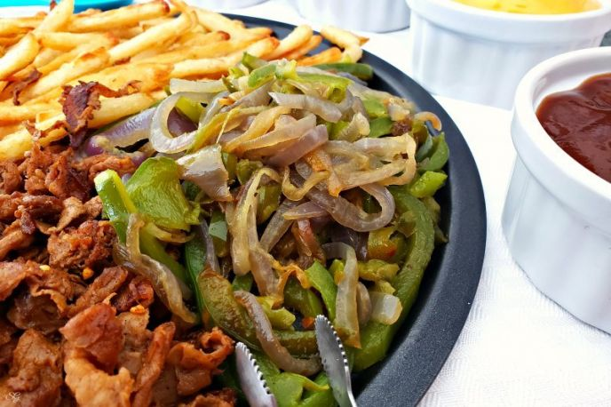 Sauteed peppers and onions for loaded steak and cheese french fries. #fries #peppers #onions #steak #cheese #recipe #easy #delicious #easyrecipes #MyMcCainPotatoes #McCainPotatoes
