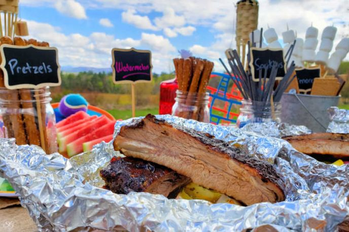 Grilled ribs, vegetable foil packs, and happy camper camping barbecue party theme idea!