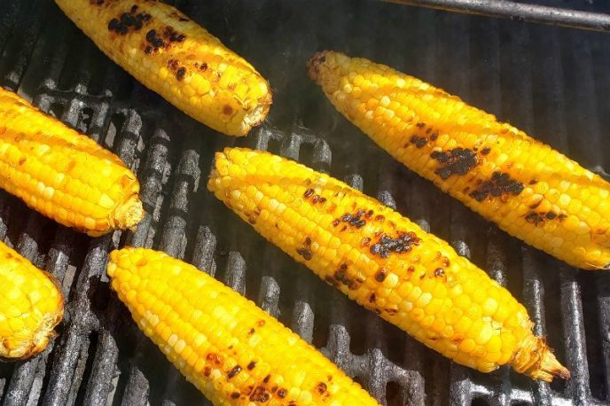 Grilling corn on the cob for Mexican street corn recipe.
