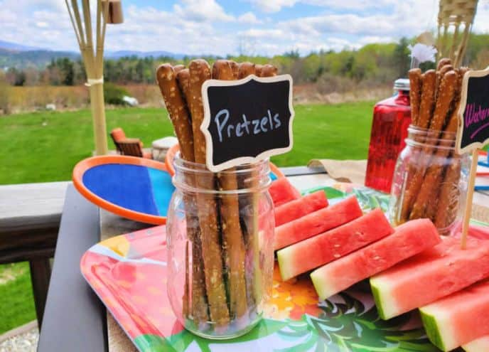 Mason jar with pretzels and chalkboard sign for BBQ party