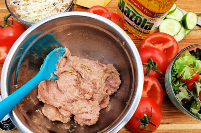 Ingredients to make juicy turkey burgers with tomato burger buns.