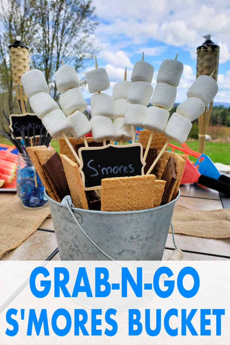 Smores Bar making station idea! Put together a s'mores bucket for easy grab-n-go s'mores! CLICK to see what supplies you'll need to make this delicious backyard or camping s'mores station.