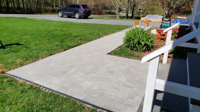 Installing polymeric sand into walkway pavers
