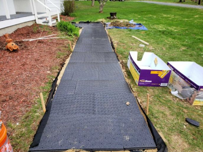 Installing paver base panels for walkway/