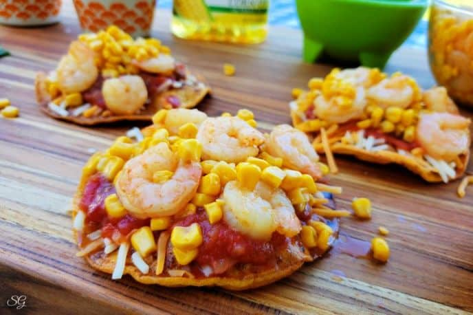 Shrimp Tostadas with corn, salsa, cheese, layered on a tortilla recipe