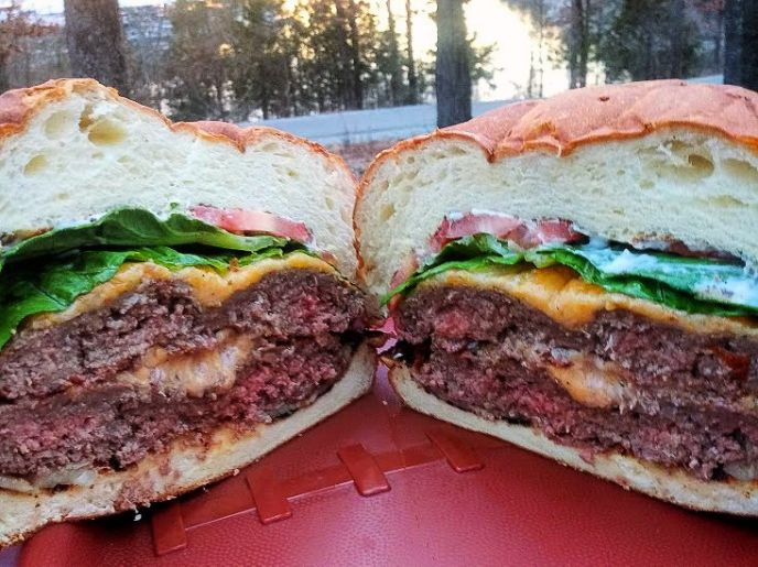 Colossal Campfire Burger cooked over a fire while camping