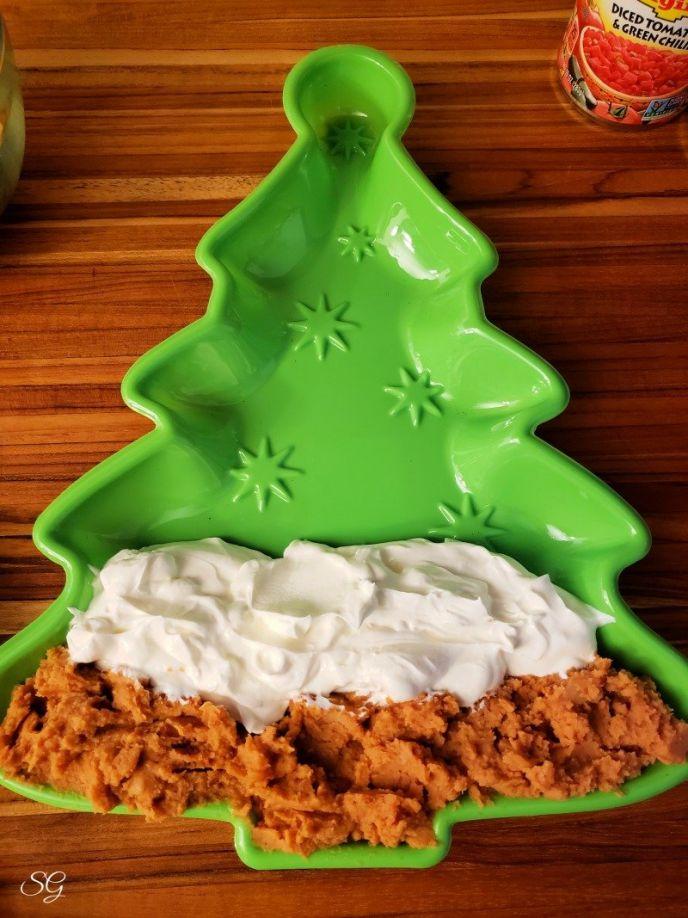 Adding sour cream to Christmas 5 layer dip recipe #gatherwithRotel