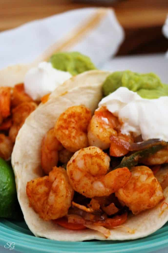 One Pan Shrimp Fajitas with veggies, yogurt, and guacamole